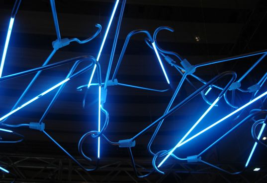 This hangar light has neon beams on it, giving the hangars a special dark blue glow.