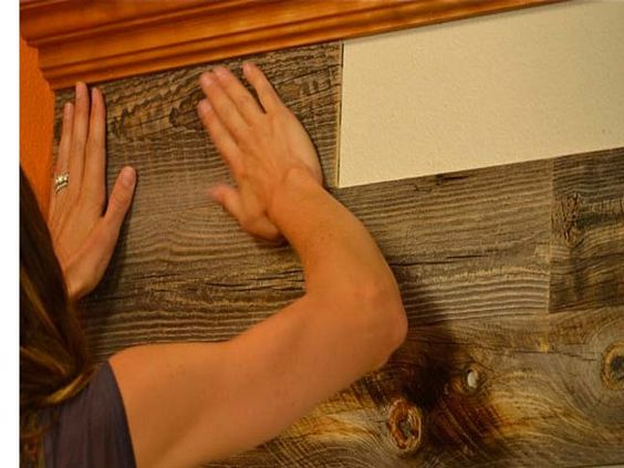 DIY: Easy Peel Stick Wood Wall Decor Could use it to make the wall by bottom bunk look like the hull of a ship