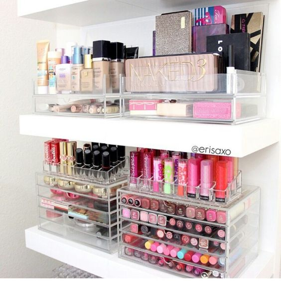 Great makeup organization in acrylic trays on floating shelves