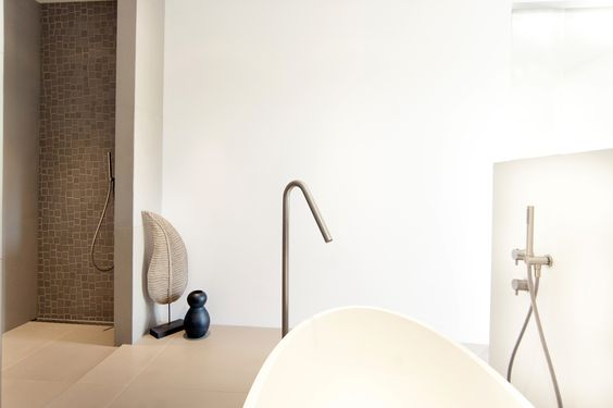 """Get inspired... byCOCOON.com for Contemporary Minimalist Modern Luxury Design Bathrooms around the Globe   Modern freestanding solid surface bathtub """"Salinas"""" by COCOON   Robust Inox floor mounted bath mixer by COCOON   Dutch designer brand byCOCOON.com    #COCOON bathroom taps are both available via inoxtaps.com and via byCOCOON.com    Bathroom design & renovation for businesses, hotels and private clients byCOCOON.com    Badkamer ontwerp & verbouwing byCOCOON.nl"""