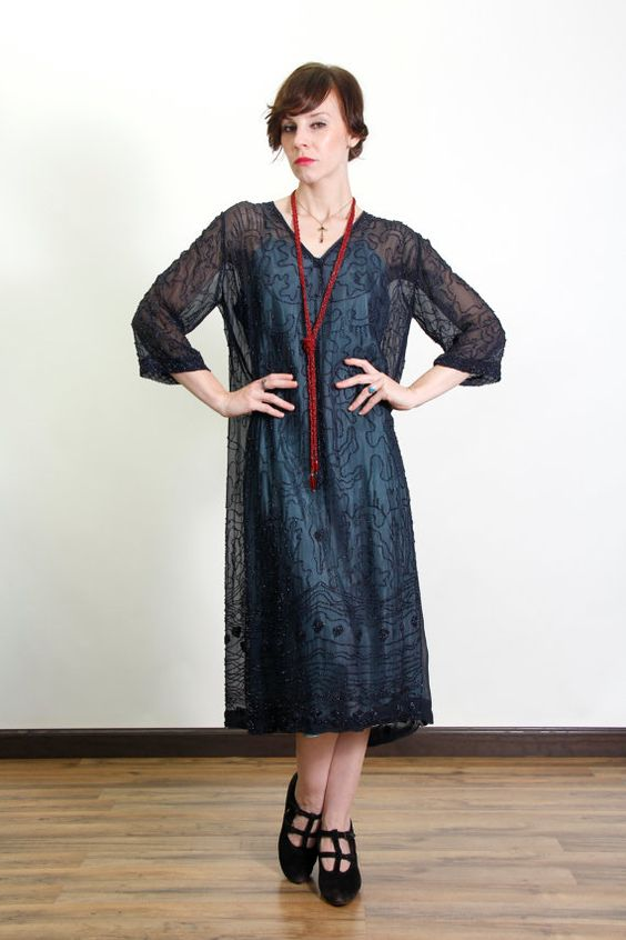 Gorgeous! A stunning antique sheer chiffon gown, entirely and intricately beaded. wowza!  circa 1910s to 20s silk-like fabric is likely synthetic. under slip and beaded lanyard not included.  shoulders across top (slightly raglan) are 16 or 40.5cm outer sleeve length is 15 or 38cm bust fits 42+ (slight stretch to fabric) or 106.5cm waist and hips are 46 or 117cm length from shoulder to hem is 42 or 106.5cm  * Vera modeled this item and you can find her measurements on our POLICIES page…