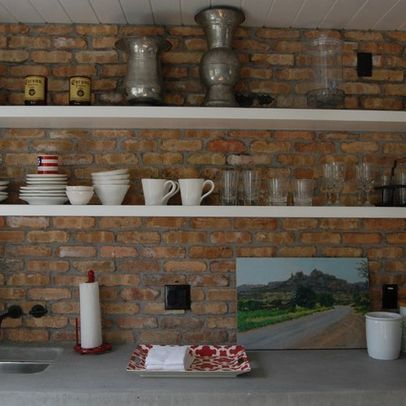 shelves on brick wall