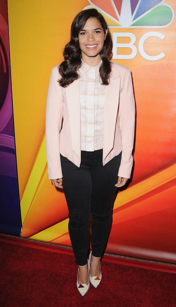 America Ferrera in a pink blazer and skinny black pants