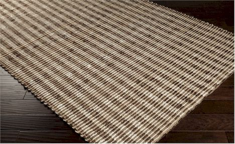 The Surya Reeds Collection features hand woven 100% jute rugs.