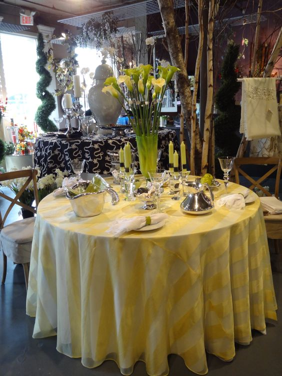 """Stop by Experience and Creative Design to check out June's """"Table of the Month."""" The yellow and green color scheme gives a fresh, summer look."""