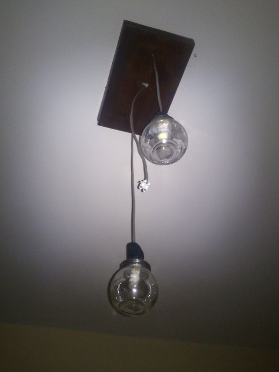 Ceiling Light with wood & jars in living room. DIY (Still got a jar to attatch in the middle)
