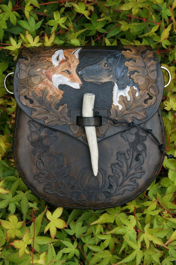 elaborate leather sporran with oak leaves, initials, a red fox ...........click here to find out more http://kok.googydog.com
