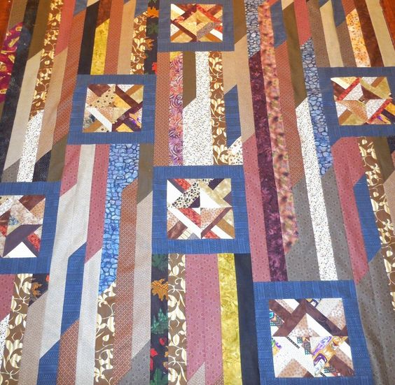 Odd Block Strip Quilt - don't have any odd blocks so I guess I'll have to make some. Like this quilt top.