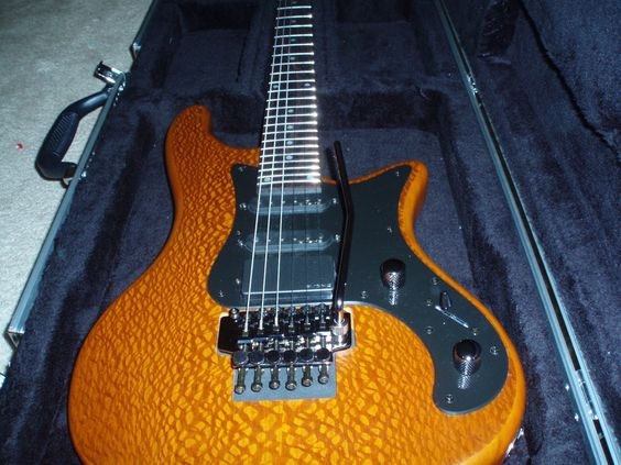 """Schecter Diamond Stiletto 6.  This short-production-run beast was sent in by Mike O'Boyle, saying; """"Schecter Guitar ResearchDiamond Series Stiletto-6 with lace wood laminate top, Floyd Rose Lic Trem, EMG-HZ pickups, rosewood finger board."""""""