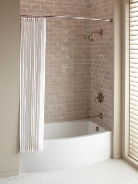 Installing a tub and shower combo will help you save both money and space in your bathroom. Image courtesy of Kohler Co. Love this tub!