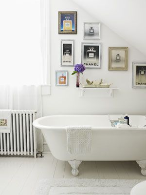 The bathroom: a clever place to display vintage Chanel No. 5 magazine ads.