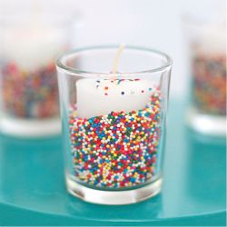 A seriously simple craft for making festive sprinkle filled candles, perfect for any party.