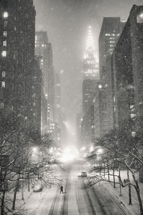 New York City on a winter night in the snow overlooking the Chrysler Building and 42nd Street in midtown Manhattan.: