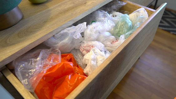 Here's the ultimate trick for storing those plastic bags It works! I have about 10 bags in a small tissue box. I will save a large tissue box for my next attempt!: