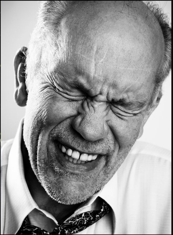 Speaking of closeup, black-and-white portraits, John Malkovich by Michael Muller. The man has this incredibly expressive face, even with something as simple as a laugh.