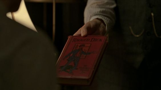 """Ragged Dick, Or, Street Life in New York with the Boot-blacks, by Horatio Alger - Boardwalk Empire Season 4 Episode 8 - """"The Old Ship of Zion"""". This book was also featured prominently in Season 3 Episode 11, """"Two Imposters"""""""
