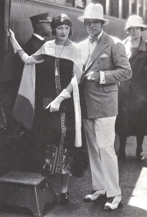 1925 Rudolph Valentino and wife Natacha Rambova leave LA by train. Natacha always wore long skirts because she felt her legs were too heavy. This is about as casual as one would get in the 1920's when traveling via train!