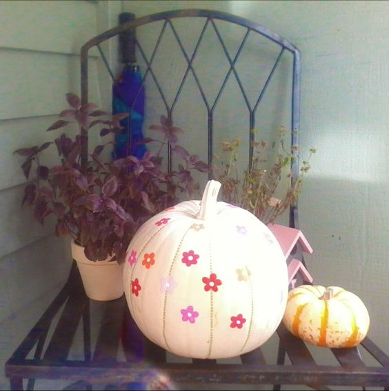 White pumpkin painted with flowers