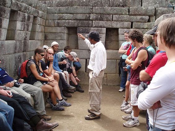 tourists and guide at Machu Picchu
