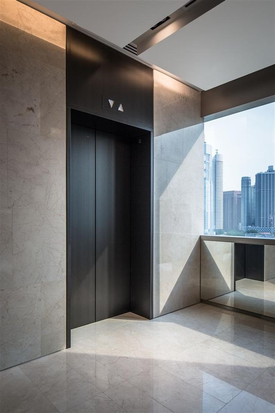Lift lobby at china square central singapore by dp design for Modern elevator design