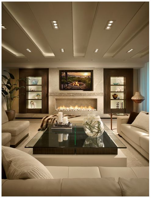 love the fireplace wall with tv built ins on each side lite