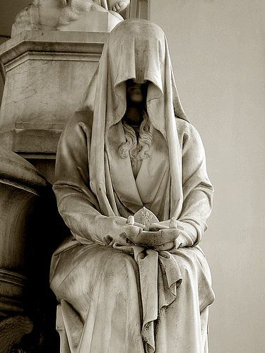 """A pleurant (French) or """"weeper"""" (in English) was a statue that was meant to mourn eternally at the grave of a loved one.  Veiled woman, via Flickr. photo by Irene Spadacin taken in Verano Monumental Cemetery, Rome, IT"""