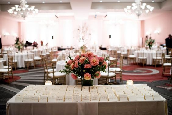 all peach/coral dahlias for guest seating table
