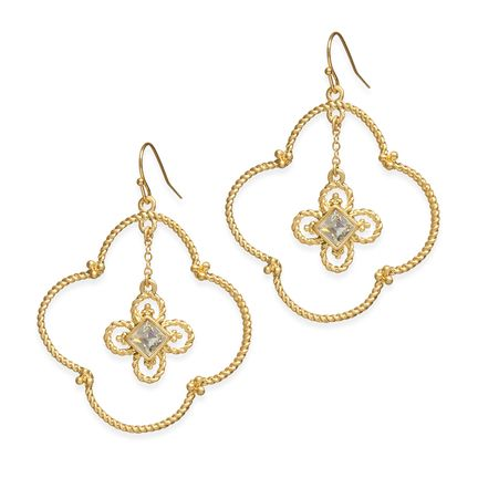Bring some attention to your ears with the Gina Earrings. These open clover earrings are punched up with a dangling clover adorned with cz. They even passed the curly hair test… they won't hide behind the curls!  Found it on the bohemian trunk