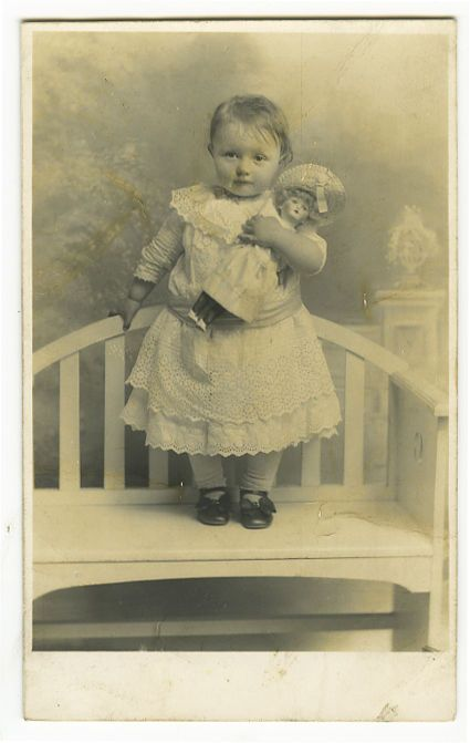 c 1910 Vintage CUTE Little GIRL w/ DOLL private photo postcard: