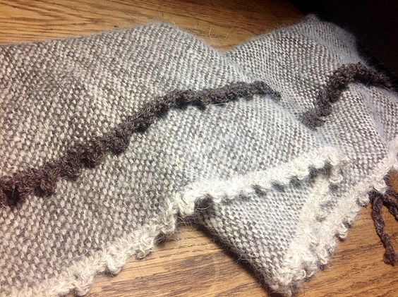 Ravelry: spinnerofyarns' Picot Edges on Handspun Chiengora Scarf - crochet edging. Interesting idea, might disguise less than perfect selvages.