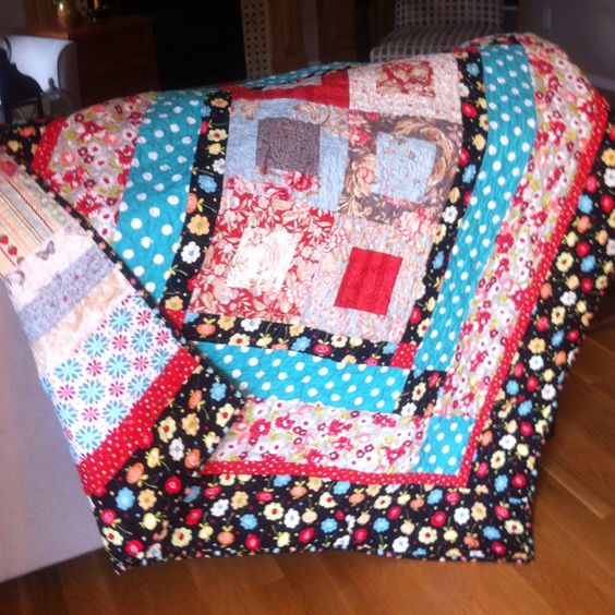 This is a fun, bright baby quilt I made for friend. Backing is left over fabric and scraps.
