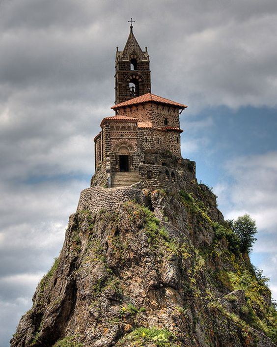 Perhaps one of the most remarkable sights in France, a chapel perched on a volcanic plug. This is the Rock of Aiguilhe, on the edge of the town of Puy en Velay, in the Auvergne. The Chapelle Saint-Michel has stood there for 1042 years, since Bishop Gothescalk had it built in 962 on his return from a pilgrimage to Santiago del Compostella in Galicia. In 1955 workers found relics under the alter that had been there since it was built.
