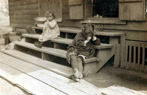 """Circa 1911, Biloxi, Mississippi. Olga Schubert, 855 Gruenwald St. The little 5 yr. old after a day's work that began about 5:00 A.M. helping her mother in the Biloxi Canning Factory, begun at an early hour, was tired out and refused to be photographed. The mother said, """"Oh, She's ugly."""" Both she and other persons said picking shrimp was very hard on the fingers. Lewis Wickes Hine LC-DIG-nclc-00891 http://www.loc.gov #American #History #Mississippi"""