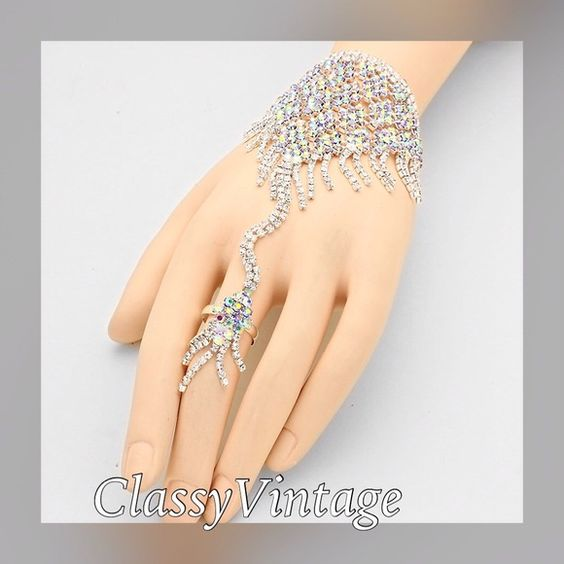 Stunning silver bracelet ring set in Rhinestones. Stunning bracelet ring combo in light catching rhinestones. Ring is adjustable and in silver tone metal. Arrives this week. $19.00 Boutique Jewelry Bracelets