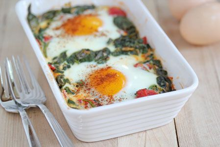 baked egg with spinach, garlic, onions and diced tomatoes