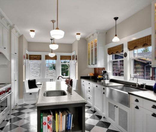 Grey And White Galley Kitchen this eclectic galley kitchen layout features vintage finishes with