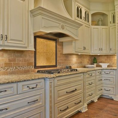 These cabinets antique ivory with mocha glaze kitchen for Antique white kitchen cabinets with chocolate glaze