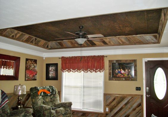 We did this tray ceiling with tin and barn wood, we also did the wainscoting with barn wood, it really made the room look good.
