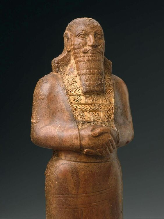 Statuette of an Assyrian king. Baltic amber with gold breastplate. Near Eastern…