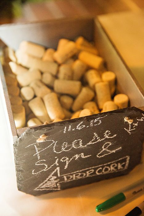In lieu of a traditional guest book, this Disneyland couple encouraged wedding guests to sign a cork