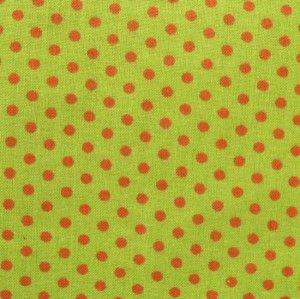 Außergewöhnlich schön: grüner Baumwollstoff mit roten Tupfen