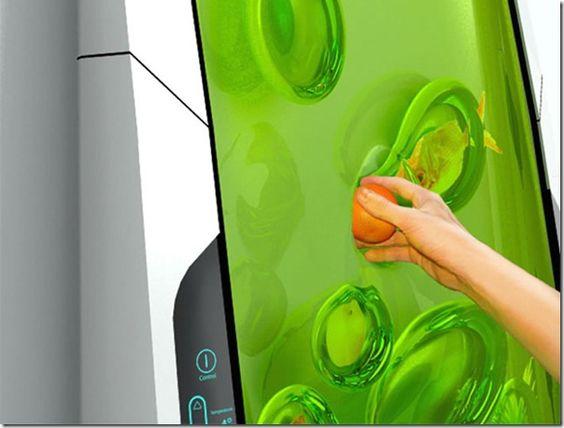 Bio-robot est le réfrigérateur du futur par Electrolux. Pas de porte, pas de compartiment, et plus besoin de dégivrer un gros frigo un peu fatigué. La surface avant (verte) est en réalité un gel biopolymère luminescentqui entoure chaque aliment indépendamment dés que vous l'y insérez. Chaque «bulle» maintient l'aliment contenu à température idéale et l'isole des autres aliments du réfrigérateur. Voilà une technologie bien étrange !