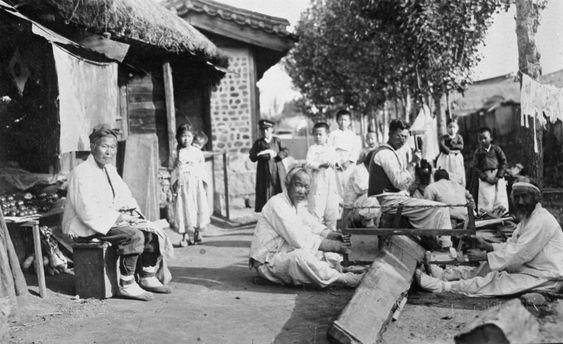 Pyongyang ca 1920-30s. Two men saw a wooden beam.