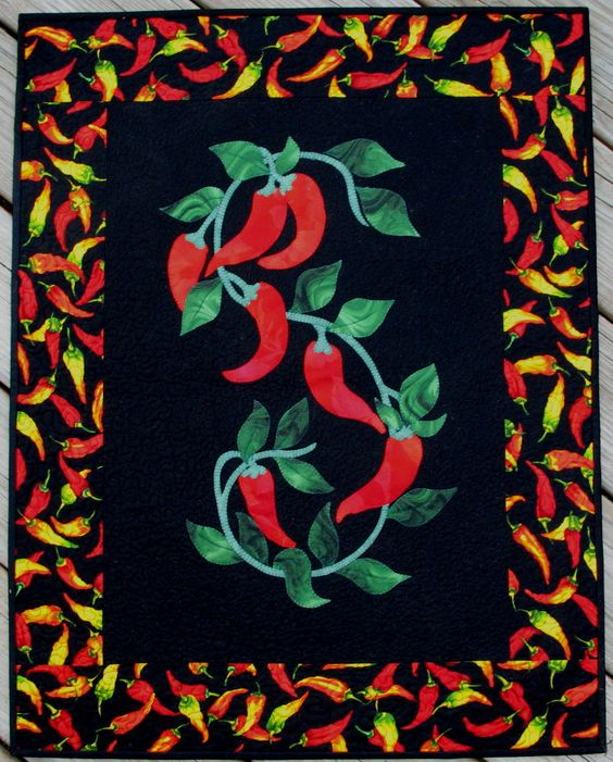 Made by @Marsha Myrum, this comment is from her:  My original design for hot chili peppers.  Made this for a friend.