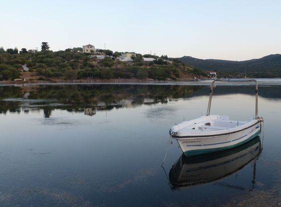 A small Peloponese (greek) village as reflected in the shallow sea waters