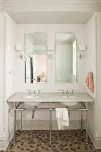 Tall mirrors, sconces, tile.