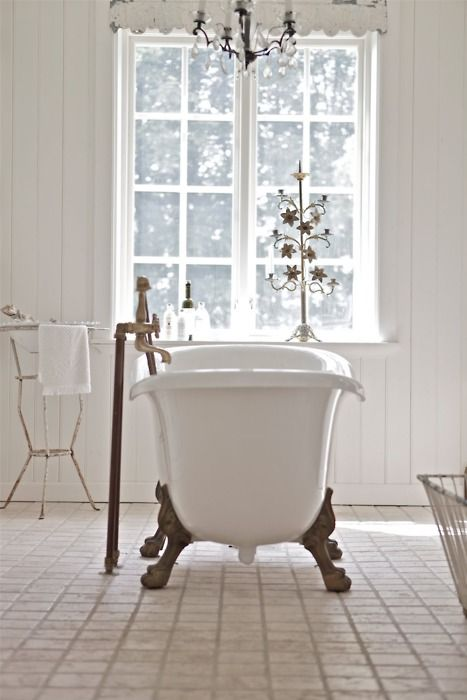 white on white interior design bathroom antique footed tub