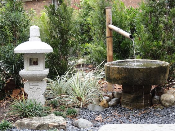 Lanterns japanese gardens and david on pinterest for Japanese water feature