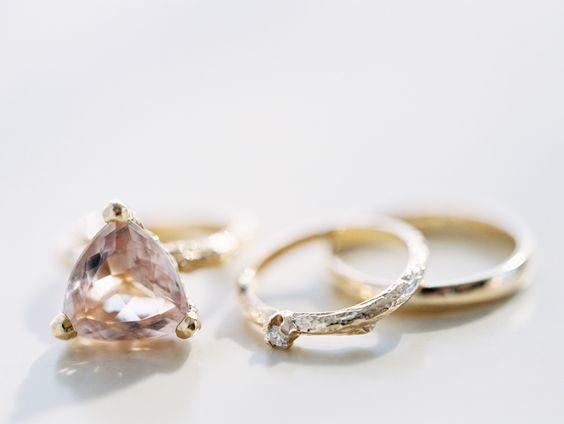 Unique triangular peach sapphire engagement ring: http://www.stylemepretty.com/2016/03/03/modern-downtown-austin-wedding-with-17-stylish-bridesmaids/ | Photography: Ryan Ray Photography -http://ryanrayphoto.com/