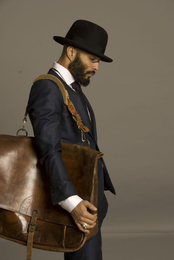 """im not sure why he's carrying a giant """"man bag"""" or why he has war paint on his nose but his beard looks so soft."""